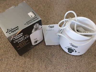 Tommee tippee bottle warmer with box and instructions