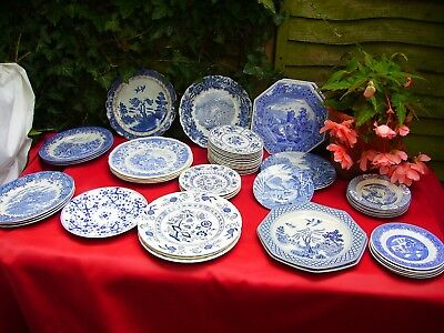 Assortment of blue and white plates