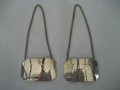 A PAIR OF SOLID SILVER CONCORDE DECANTER LABELS - Whiskey & Gin.