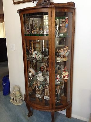 Antique Bowed Cabinet With Green Stained Glass