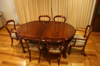 Antique extension table and 6 reproduction chairs