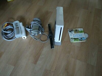 Nintendo Wii White Console with controller and Wii sports.