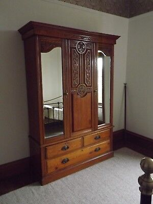 Victorian oak wardrobe, two mirror doors with three drawers, canopy over.