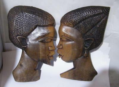 Carved African wall plaques-male and female