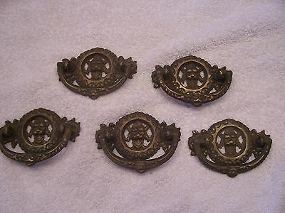 Antique style brass drawer pulls with northward or green man face