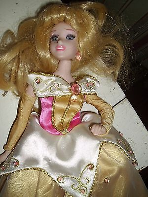Sleeping Beauty porcelain doll, 14 inches,,, gold dress