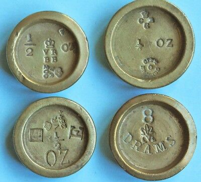 Four Victorian brass 1/2 ounce weights, with interesting marks