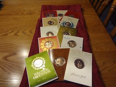 Franklin Mint Christmas cards with Coins/Medals 1968- 1974.  12 in the lot