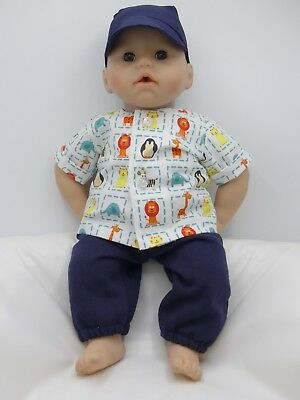 18in Dolls Jogging Bottoms, Patterned Shirt & Navy Cap .Fit 18in/46cm George
