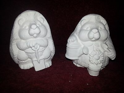 Ceramic bisque pair of Hedgehogs with flower. approx. 100mm. To glaze or paint