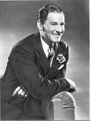 ERROL FLYNN 8X10 PICTURE SUAVE DEBONAIR WITH PIPE PHOTO - $11 95