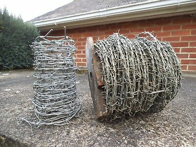One roll of heavy duty barbed galvanised wire plus a small off cut