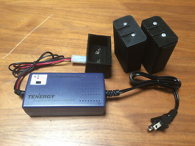 Canon Scoopic 16M or MS, 2 new NiMH batteries,1 charging base and charger.