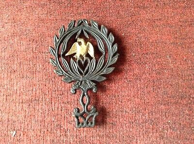 Vintage laurel eagle Wilton footed cast iron trivet