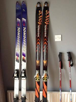 2 pairs of skis Rossignol and Salomon Force with poles and bag