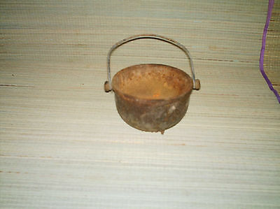 Small antique cast iron smoker kettle.