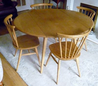 Vintage Ercol  Light Elm Drop Leaf Table and four Windsor chairs 1960s