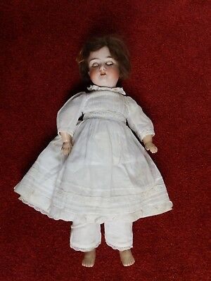 """Antique doll, 18"""" bisque face, hard body, jointed limbs, opening eyes, German"""