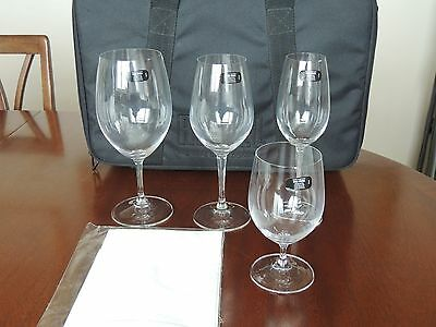 Riedel set of four assorted wine glasses in Riedel carry case .