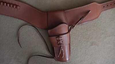 Western/Cowboy Holster handmade of the finest leather with steel interlining.