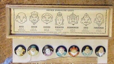 Vintage glass buttons showing the SEVEN FORTUNE GODS in original wood case