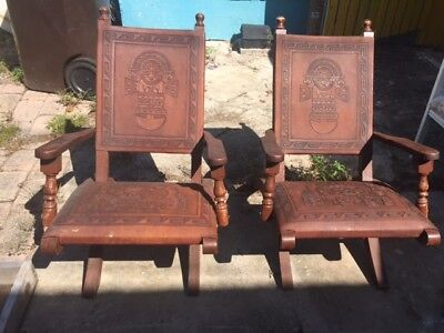 Pair of Antique Style Leather Embossed Folding Arm Chairs.