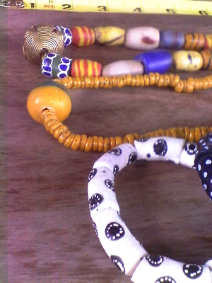 5 pieces African trade beads, 2 necklaces 1 graduated, 3 bracelets white black