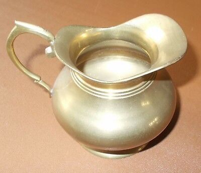 Small solid vintage brass jug. Height = 9.5cm