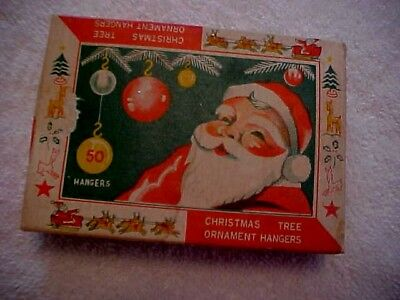 Vintage Box Of Christmas Orn. Hangers Showing Santa -