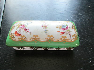 Used small oblong trinket dish with lid. green with flowers