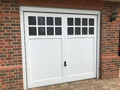 Painted white timber woodrite garage door including automated opener
