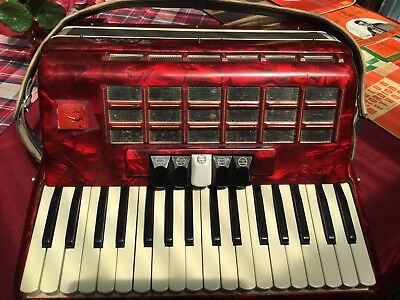 Piano accordion with instruction books