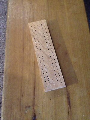 Solid Oak cribbage board.