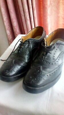 1 pair of black brouge dress shoes Size 9 studded heal and toe plates