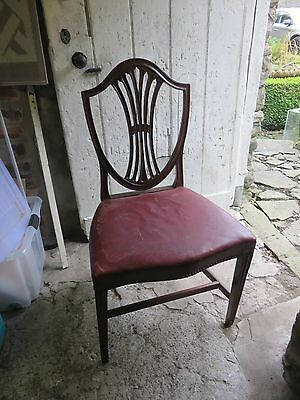 Two Antique mahogany shield back dining chairs with leather seats