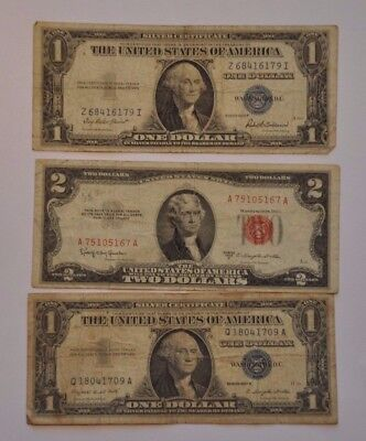 Nice group of three early small size note. Two Silver Certificates and one Red