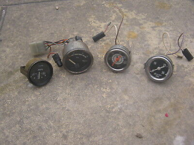 A Collection Of Four Vintage Car Gauges