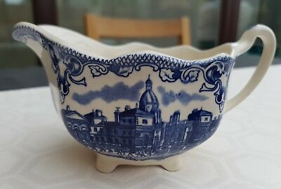 Blue and white sauce boat. Wavy rim.
