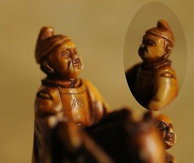Signed netsuke of a Chinese Warrior Riding On Horse