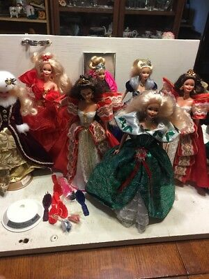 Lot Of 7 Special Edition Happy Holidays Barbies No Boxes. All Have Stands