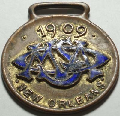 """1909 ENAMELED WATCH FOB from NEW ORLEANS """"Ship Chandlers"""" WOODWARD WRIGHT & CO."""