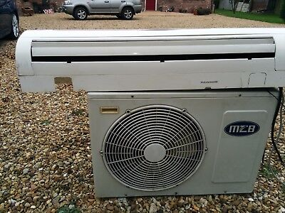 Split Type Air Conditioning Unit, Complete with Remote and Manual.
