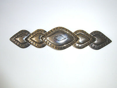 Decorative women's belt buckle in gold and silver