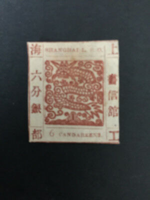 In 1865, the dragon stamps were issued in Shanghai, China