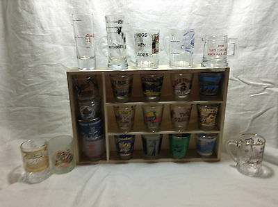 24 shot glasses from around the US and Canada