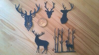 Black card die cut various stag silhouette shapes x 20