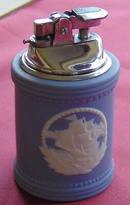 Blue Jasperware table lighter with white applied sailing ship motif. (gas)