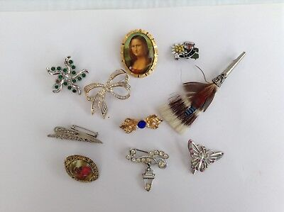 Lovely selection of10 brooches. Some Vintage.