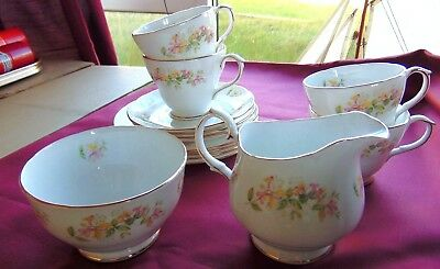 A part Bone china tea set by Duchess. Honeysuckle pattern. Selling for spares.