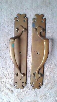 Large heavy pair of brass antique door pull handles